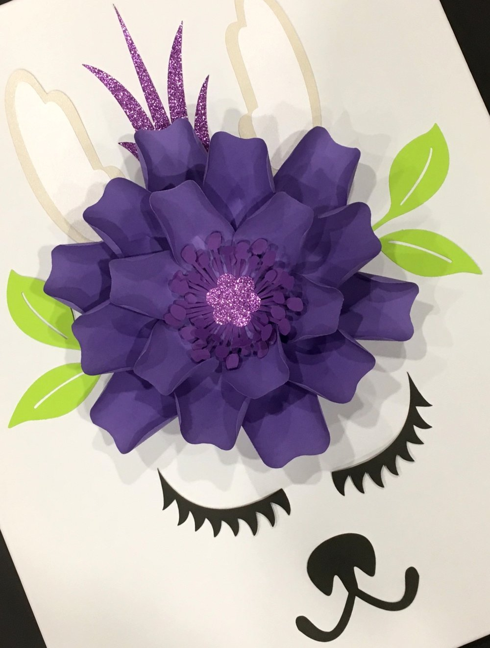 """Llama Kit ($12) - What's included?- 1 ready made 9"""" paper flower (choice of color)- 1 glitter paper tuff (pink, purple, or teal)- 1 set of ears- 2 set of eyelashes- 1 nose- 1 set of leaves***** .Does not include 16"""" x 20"""" canvas *****How To Buy: Send us an inquiry"""