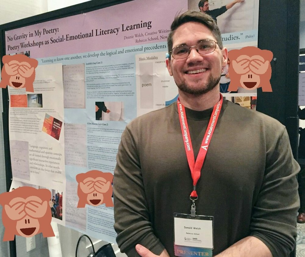 "Donnie Welch, young caucasian male, stands in front of an academic poster title ""No Gravity in My Poetry: Social Emotional Literacy Learning"" He smiling and in a green turtle neck. Red conference lanyard around his neck. Images of students have been censored out using ""hear no evil, see no evil, speak no evil"" monkey emojis."