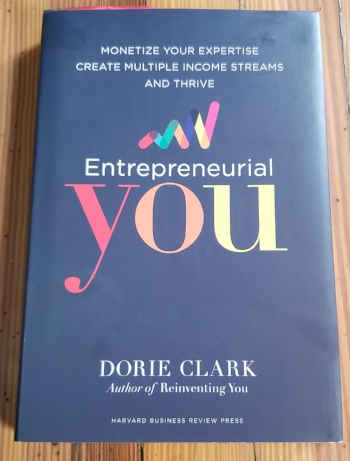 Still of Dorie Clark's  Enrepreneurial You ,  hardcover edition on a wooden table