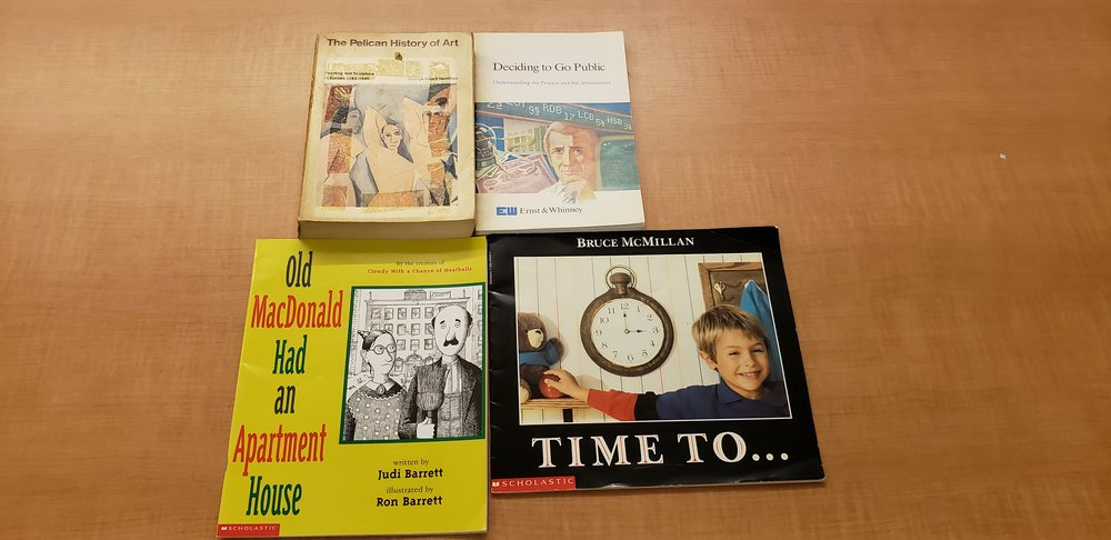 Four source books arranged in a square. The top two books (left to right)  The Pelican History of Art  and  Deciding to Go Public . The Bottom two (left to right)  Old MacDonald Had an Apartment  and  Time too…  The books are all on a wooden table.