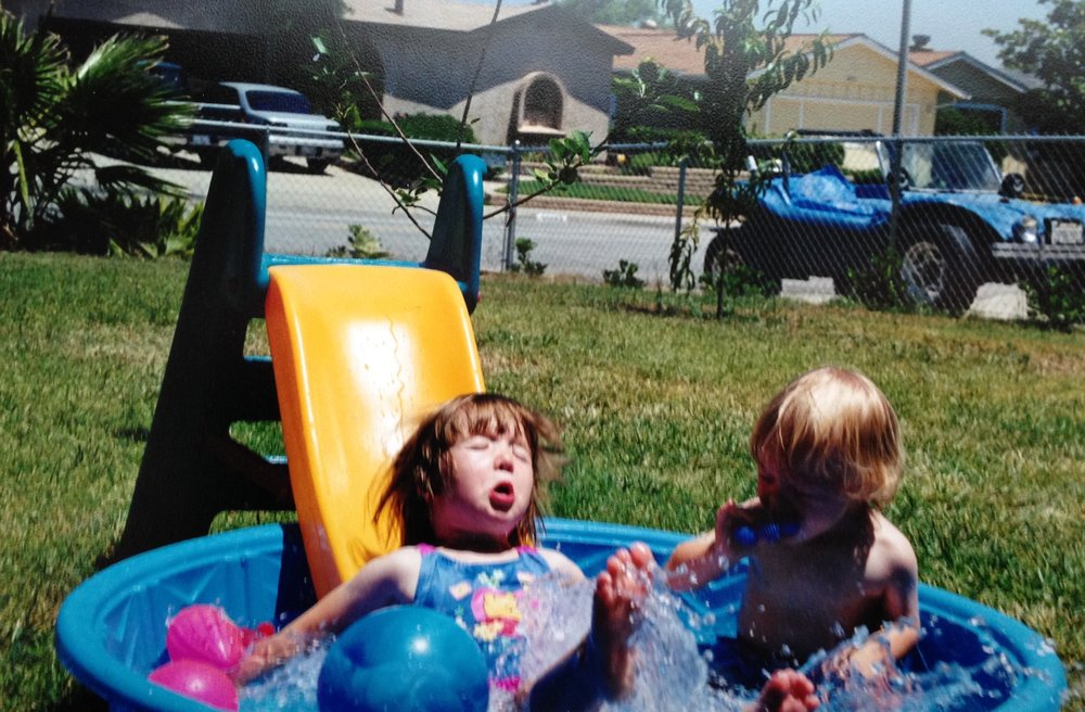 Michael and I loved to play in our little pool in our front yard when we were kids. Mama T has impeccable photography timing skills ;)