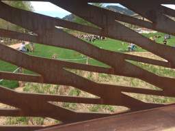the park filtered through the laser cut pattern on the bridge