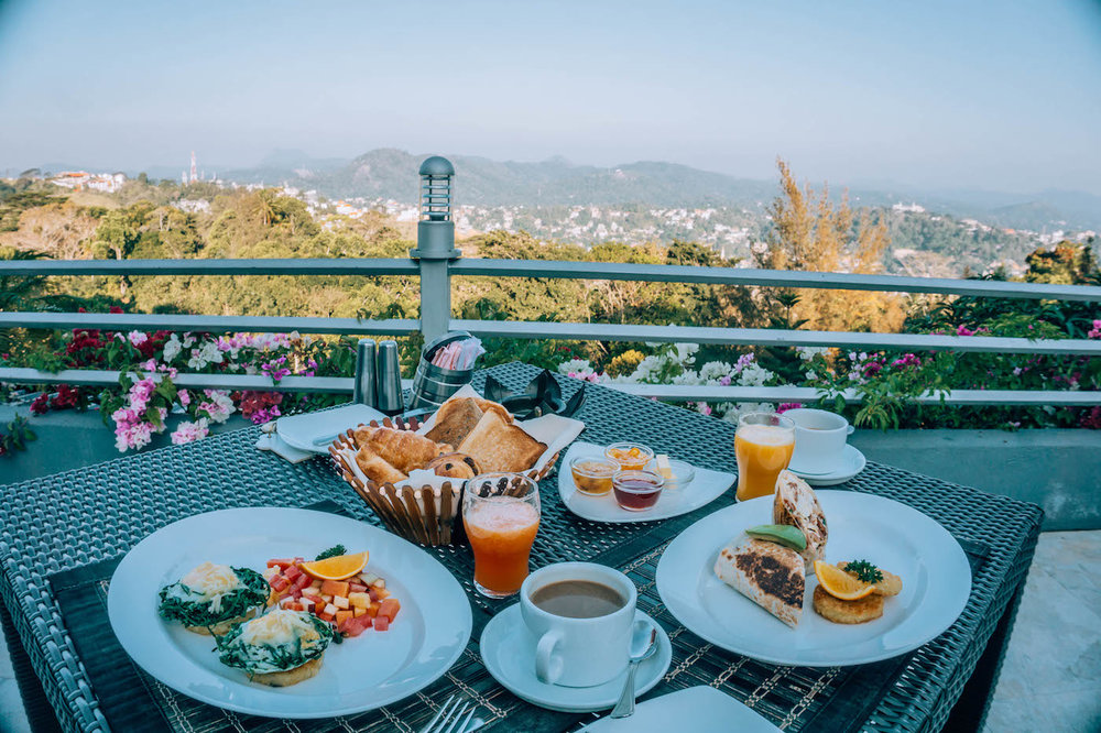 Enjoying an incredible breakfast at The Theva Residency with amazing views of Kandy