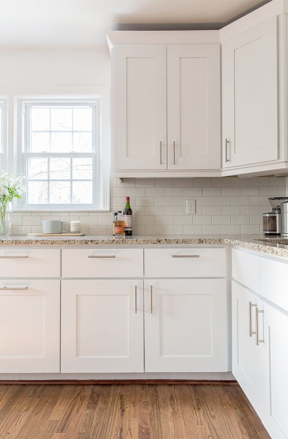 white kitchen, granite counters, subway tile