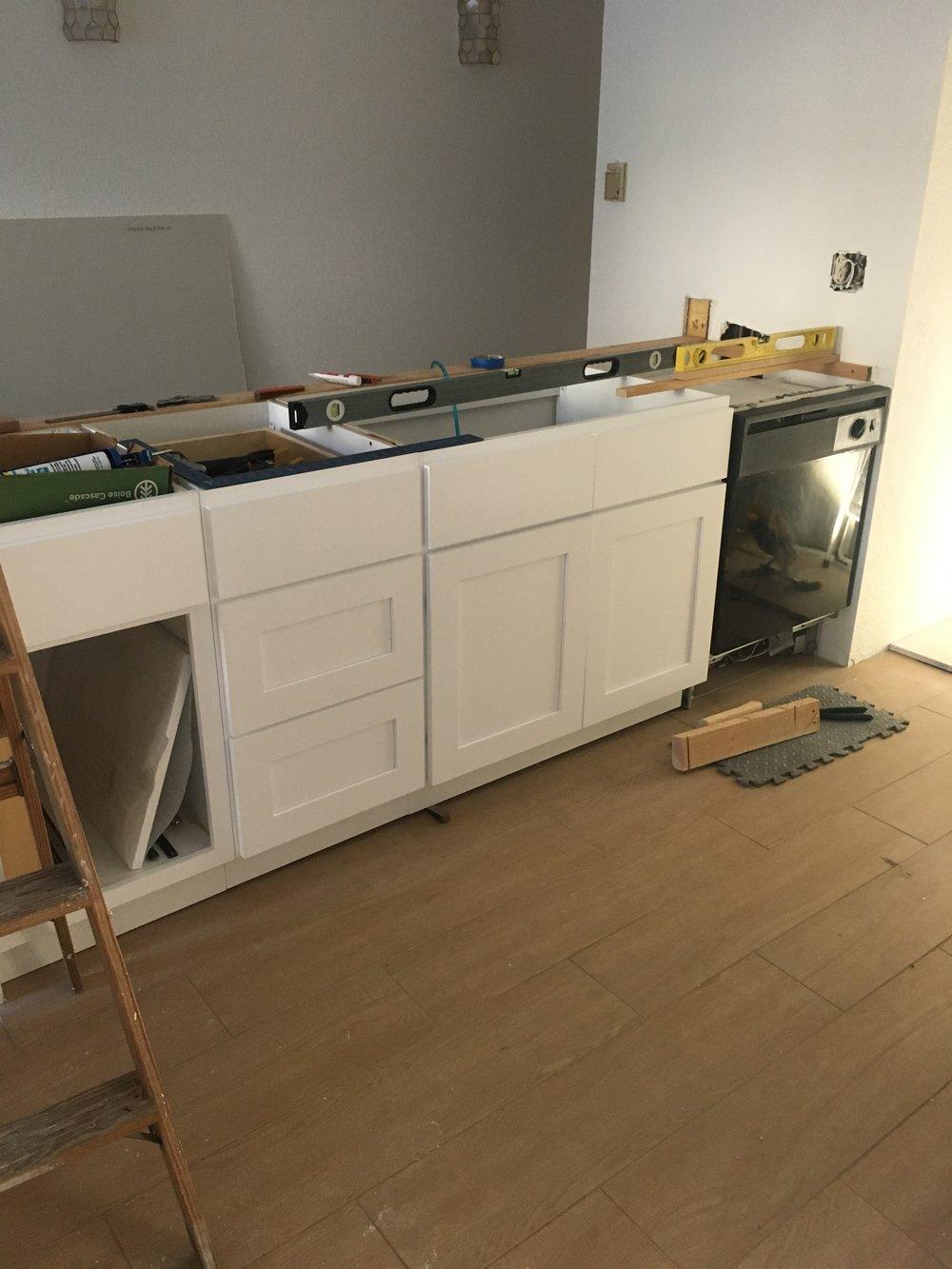 kitchen island, cabinets