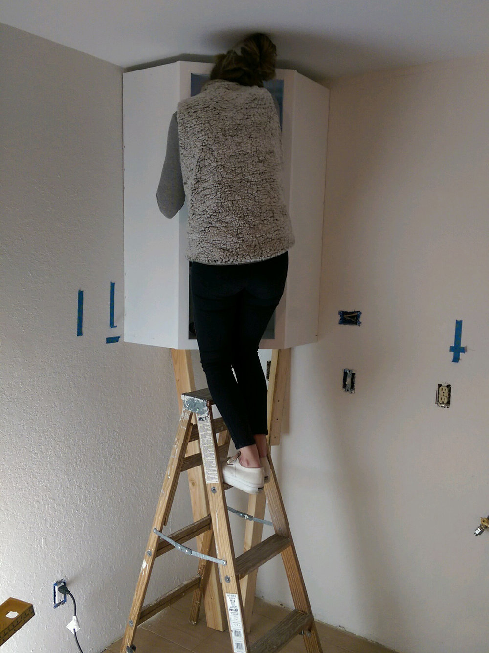 installing cabinets, kitchen, remodel