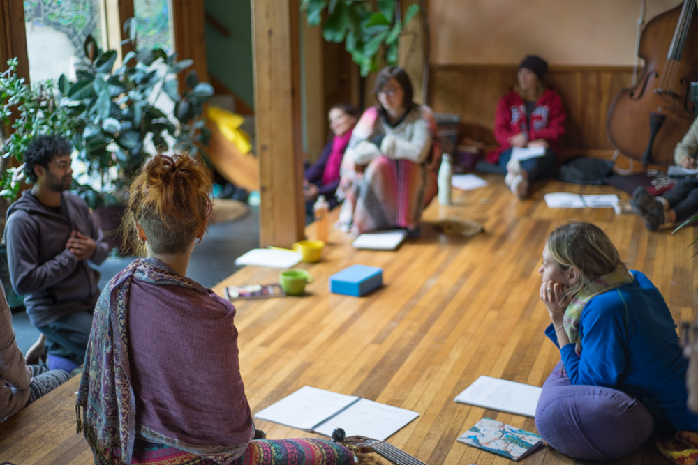 Our beautiful yoga/ceremony space is surrounded by old plants and big windows.