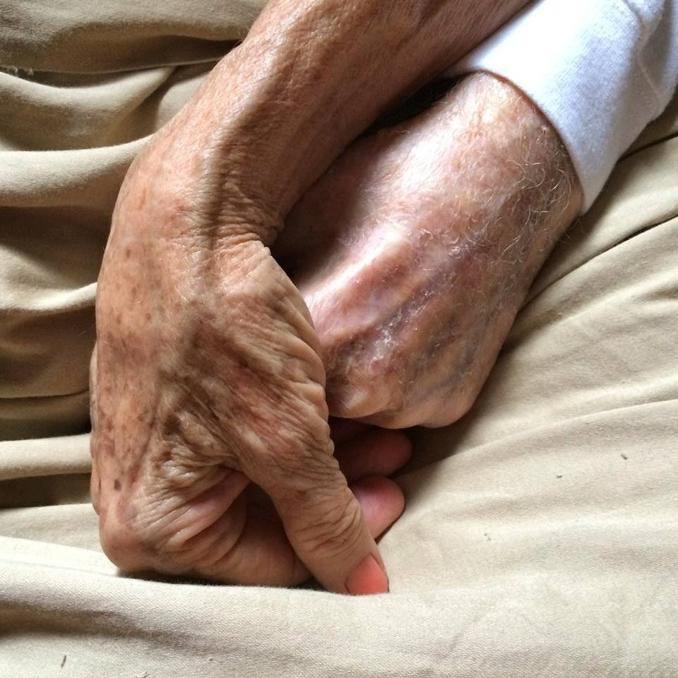 My other Grandparents, Al and Jeanne, holding hands before my Grandfather's passing at age 101.