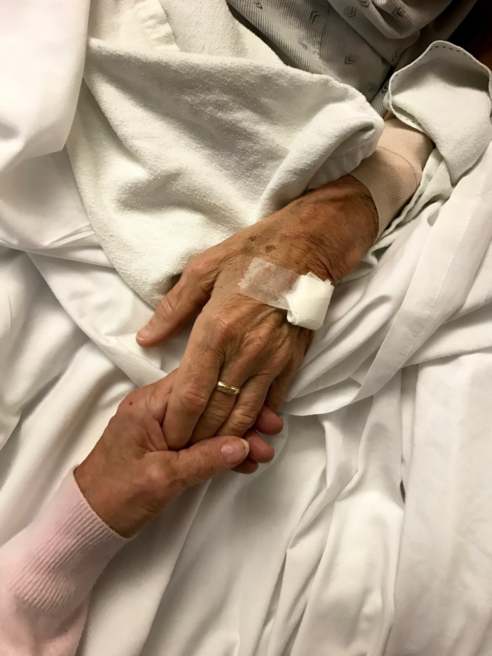 60 years of marriage... - Grammy holds her husband's hand the day before his passing.