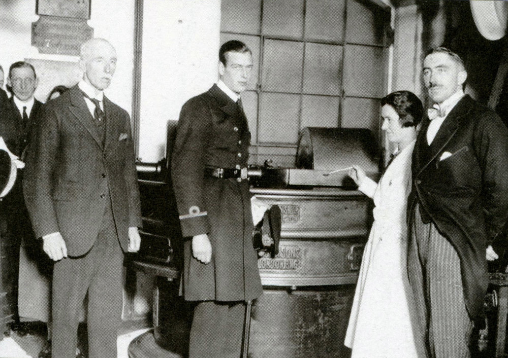 c. 1935. Prince George, Duke of Kent, being offered chocolate in Bristol, as Cecil Fry (great-great grandson of Joseph Fry) looks on.