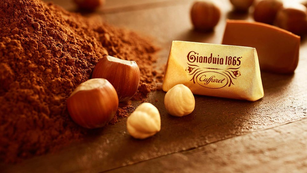 Developed Gianduia in 1865 when cacao was expensive and hazelnuts used to make chocolate more affordable.