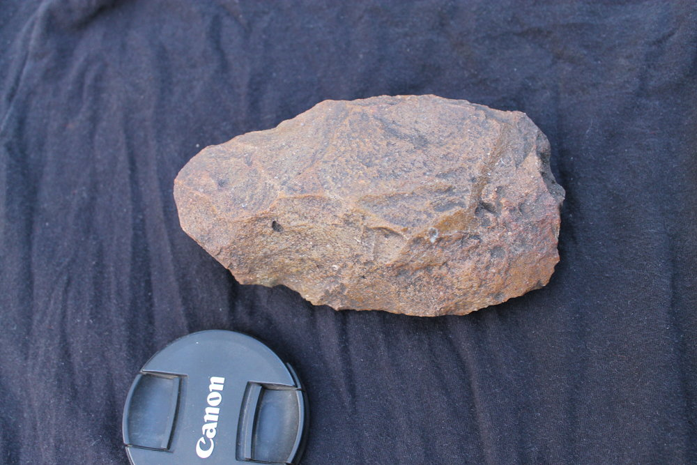 Paleolithic handaxe found during surveys around the site of Salumano Village, southwestern Zambia.