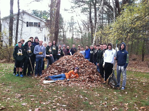 Boys Varsity Soccer Team Yard Clean Up