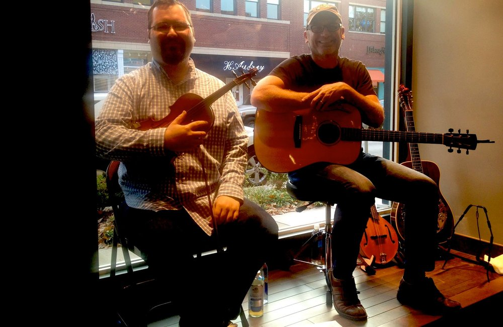 Playing in a storefront window with master musician Justin Branum (Sons Of The Pioneers)