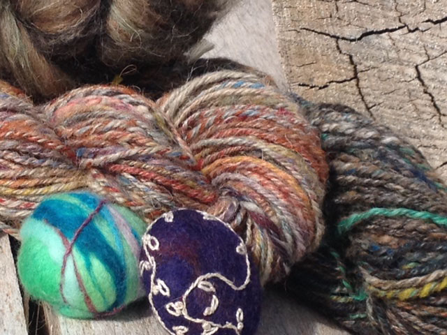 Hand-spun yarn and felted stones