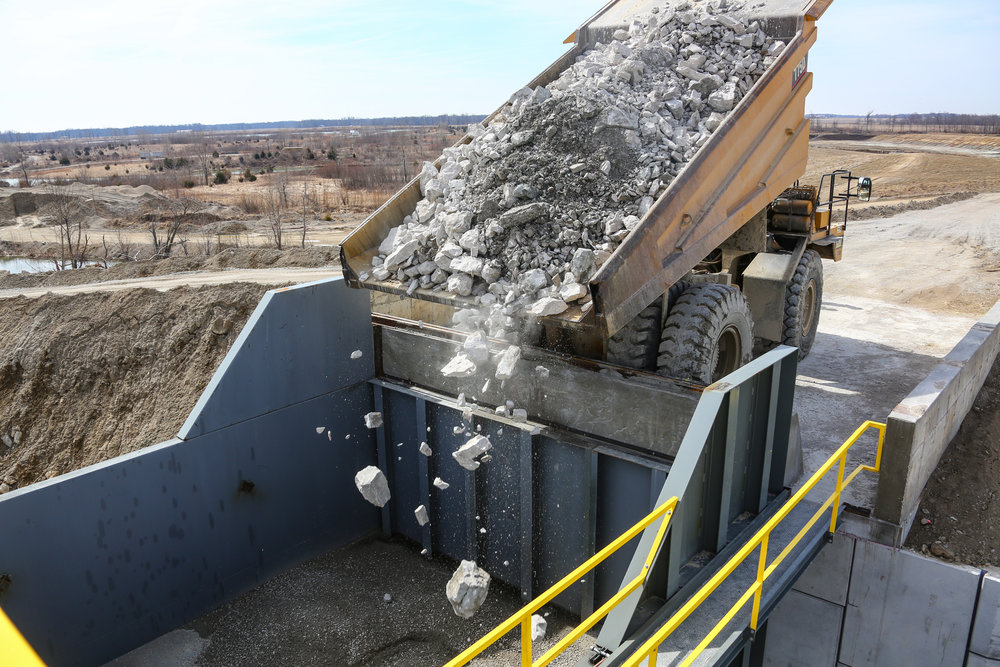 First Rock being Dumped into the New Plant - March 31, 2014