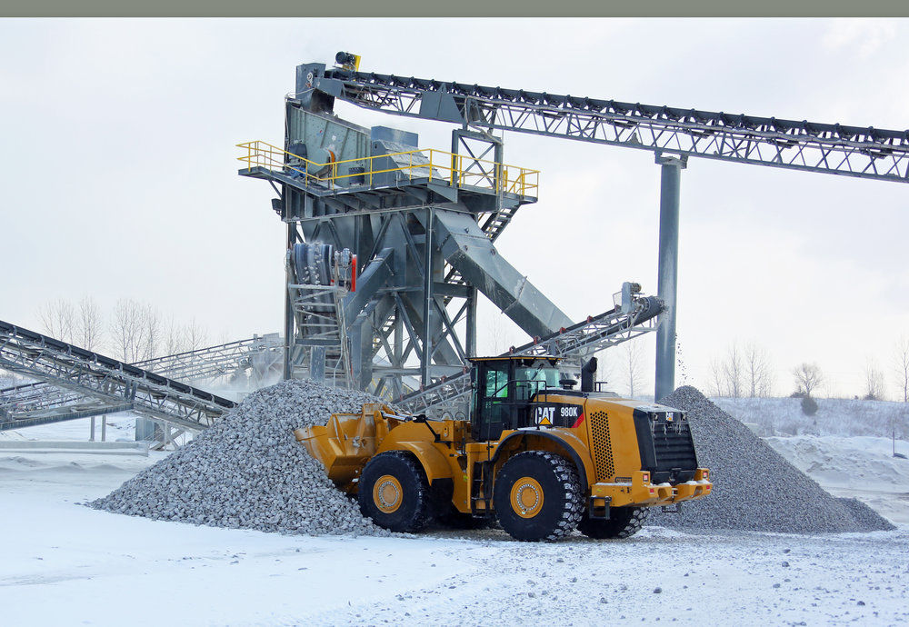 New Caterpillar 980K Stockpiling Rock - February 2015