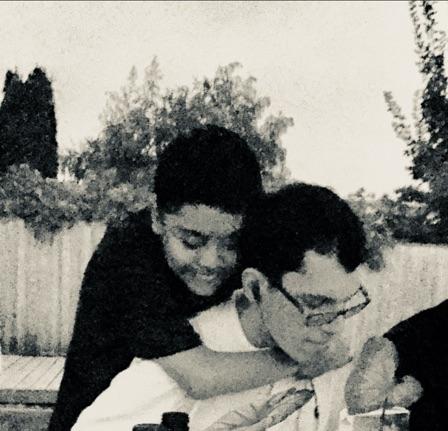Carlos y Kevin,auto-defensores, amigos e hijos.