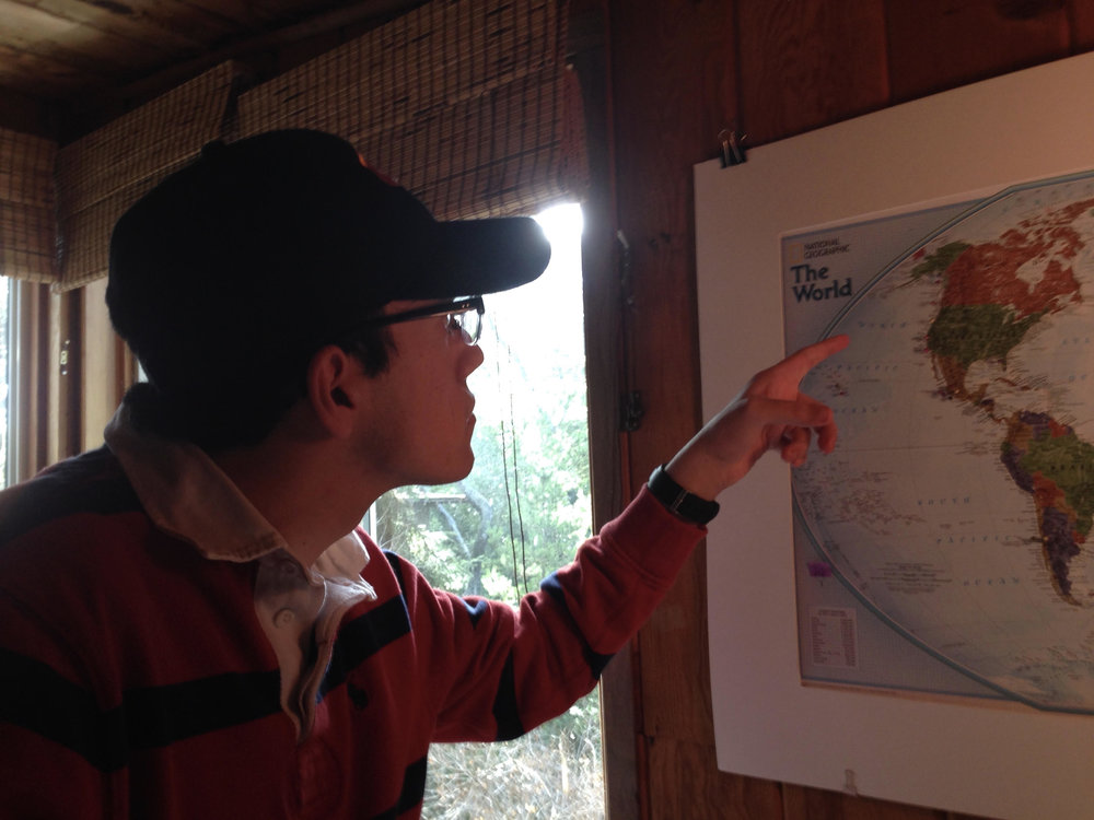 Kevin, who loves maps, points to his home in Eugene, Oregon.