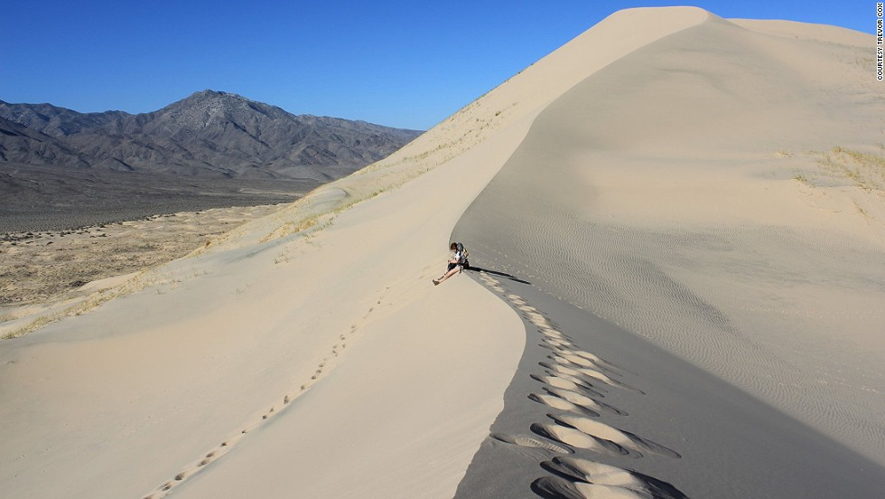 PEAK: Kelso Dunes! - Come peak some sandy peaks! We'll climb up the sand pile, chill at the top, and frolic all the way down!DIFFICULTY: 3/5SCENERY: Lots of sand. Think sand, but more.FUN FACT: The tallest dunes rise up to 650 feet (200 m) above the surrounding terrain.