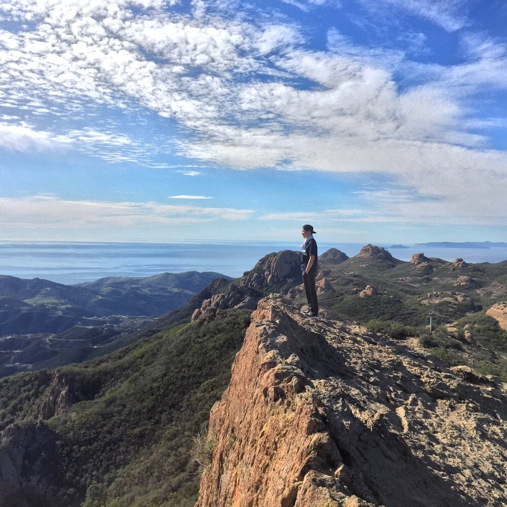 PEAK: Sandstone Peak - DIFFICULTY: 3/55.6 mile trail with almost 1400 ft of elevation gain.SCENERY: Canyon views, wildflowers (hopefully), ocean views
