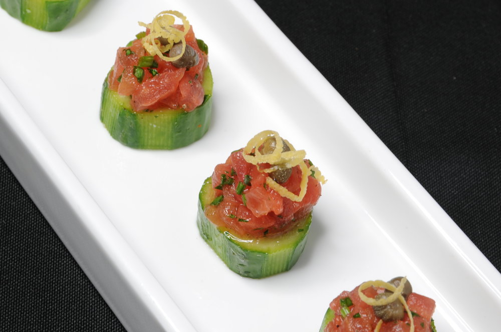 Tomato tartare with capers in a cucumber cup