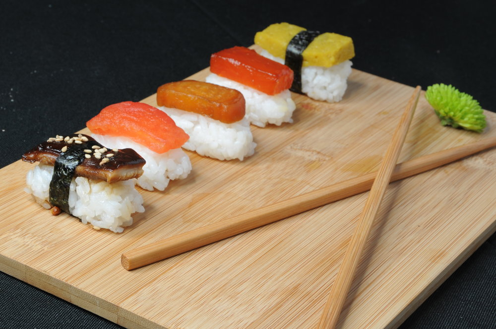 "A selection of vegetable nigiri, including a glazed portobello, tomato, roasted beet, watermelon, and chickpea ""tamago"""