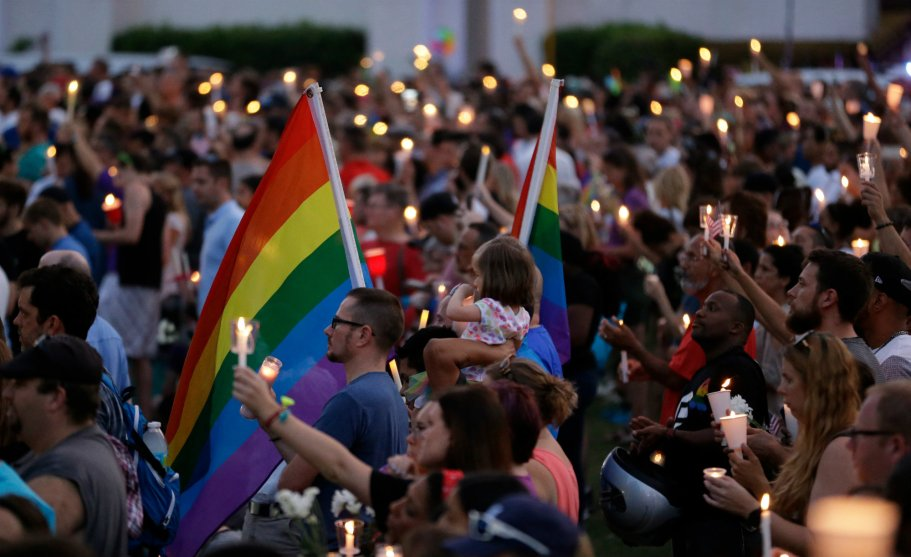 crowd with candles and flags.jpg