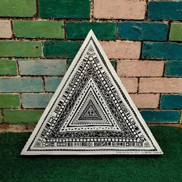 'Hidden From The Law' 2019 Posca on canvas  The other day I found a bunch of lovely triangular wooden frames tucked away in the corner of our warehouse. Originally they were part of a set for our Burning Seed theme camp, but I'm currently repurposing them into canvases. Here's the first one...