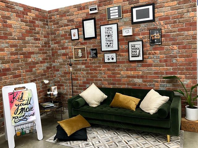 Love this cosy spot for whãnau to relax by our entry and art studio  #childcaredesign #loft #newyorkloft #velvetcouch #photowall #childcare #reggioinspired
