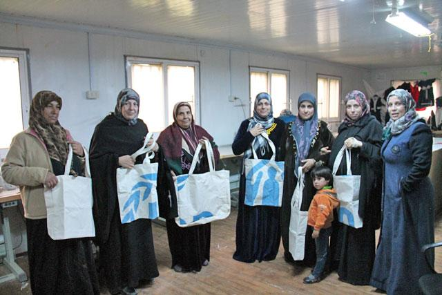 Syrian women participating in an upcycle project. Photo Credit: Camille Dupire/ The Jordan Times