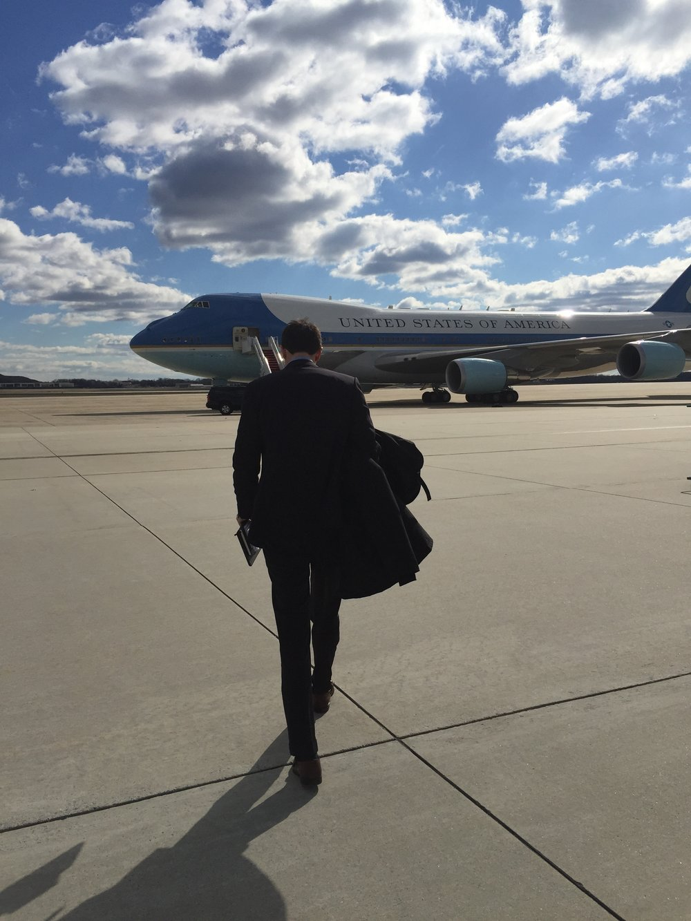 Andrew walking to Air Force One to interview President Obama in 2016.