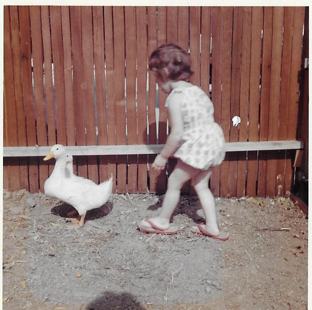 Fun Fact: - Diane had two pet ducklings when she was a child. This is a photo of her with Edie and Egbert, her ducklings! Can you guess which one of her pictures books they inspired?  Answer: LOVE IS