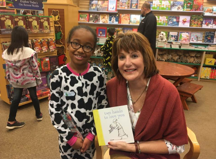 a book signing of TWO HANDS TO LOVE YOU with a storytime friend