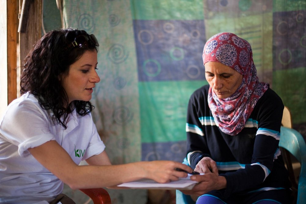 Najah talks with Rachel from Kiva about her loan. Photo courtesy of  Kiva.org .
