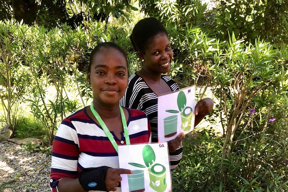 Women volunteers teach their peers how to turn their waste into valuable natural resources.  Photo courtesy of    SOIL   .