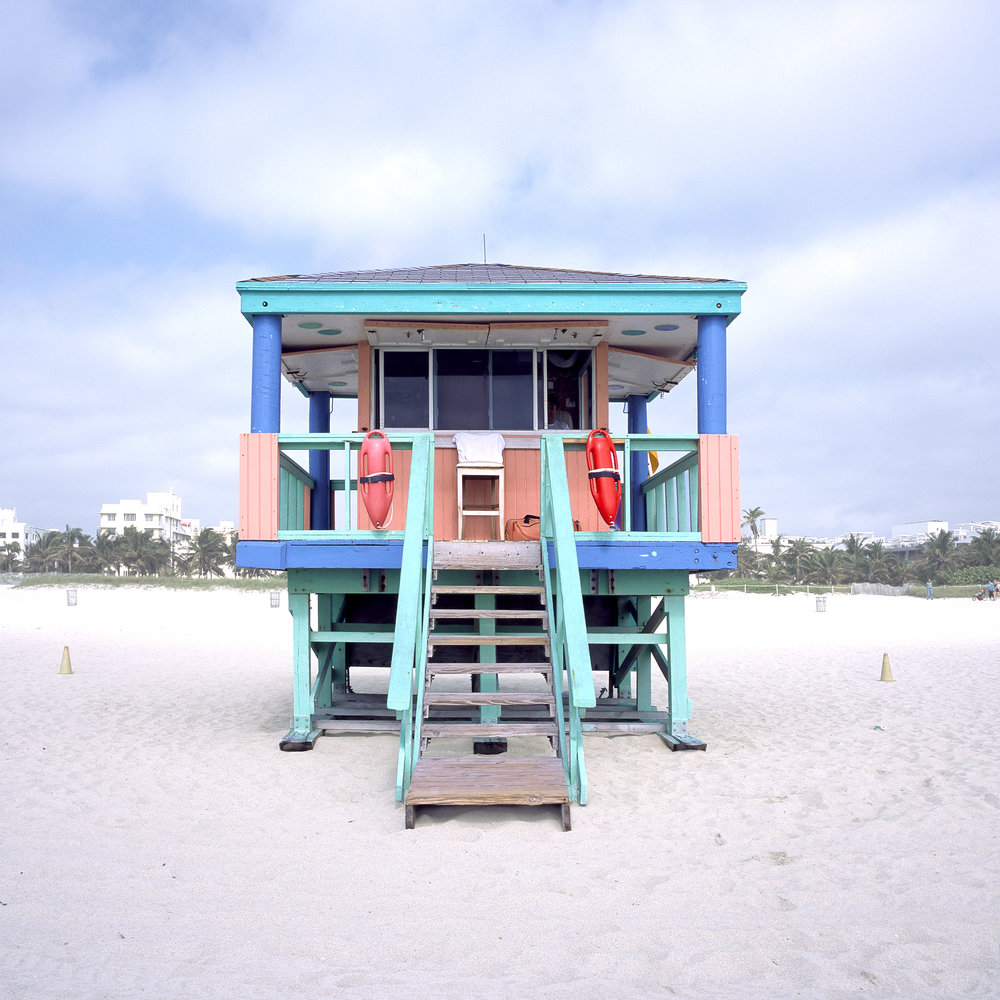 The Lifeguards        Serial portraits of Miami beach lifeguard houses that are an ever-present part of its landscape - showcasing their loneliness and at the same time their intricate colorful designs that make each of them unique.