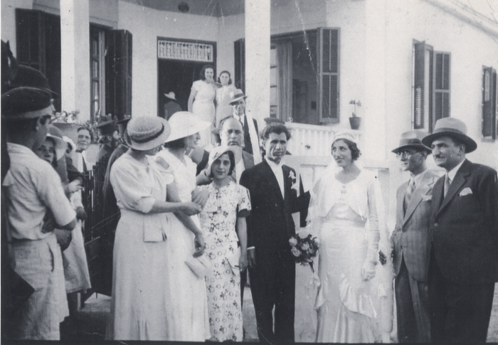This is the wedding of Emily's mother and father and is the only photo that shows the family home in the background.