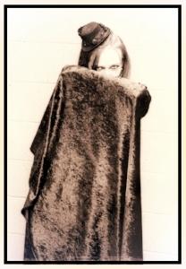 Leslie behind cape