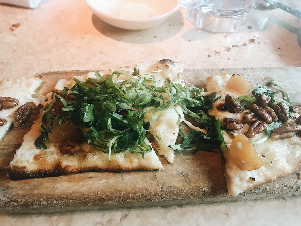 "Goat cheese, caramelized onion, pears, pecan and arugula flat bread. This flatbread is from the ""Cheese Cake Factory"""