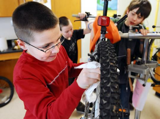 Sixth grader Luke Konishesky, 11-years-old, works on a bike at Lyme Old Lyme Middle school that will be shipped to Haiti to help earthquake victims there. (Photos by Peter Casolino)
