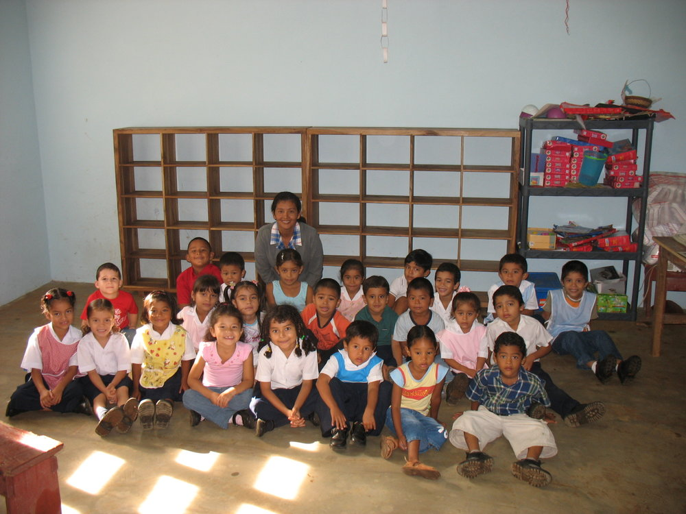 Pre-school class shown with new shelving donated by Bogazzi Inc.