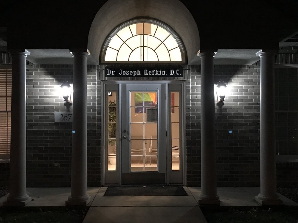 Exterior, night time view of Dr. Refkin's practice building.
