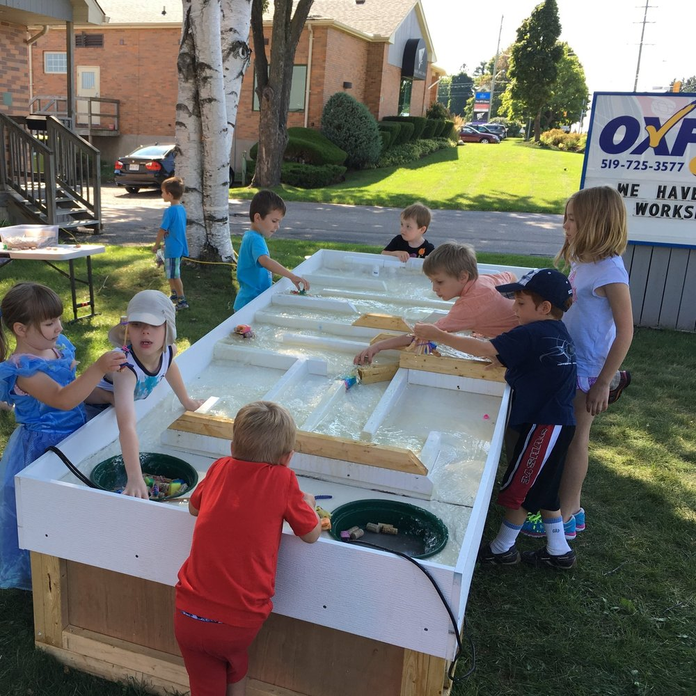 Students at Oxford Learning Centers exploring boat designs with our Portable River on a hot summer morning.