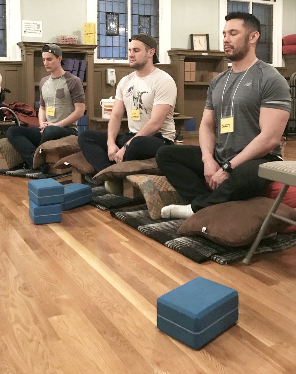 If you're on the floor, yoga blocks give the knees stability
