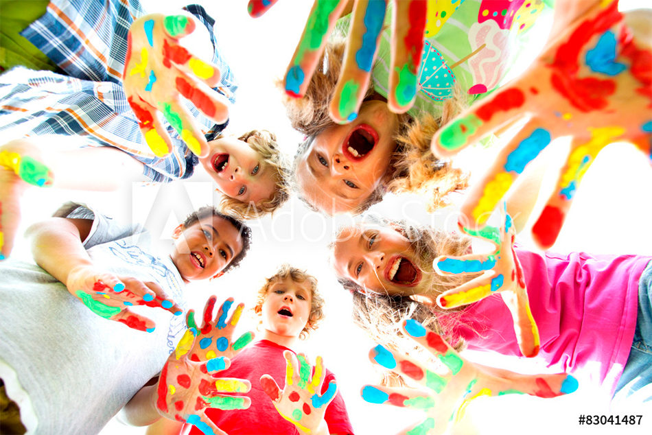 smiling kids with colourfull hands.jpg