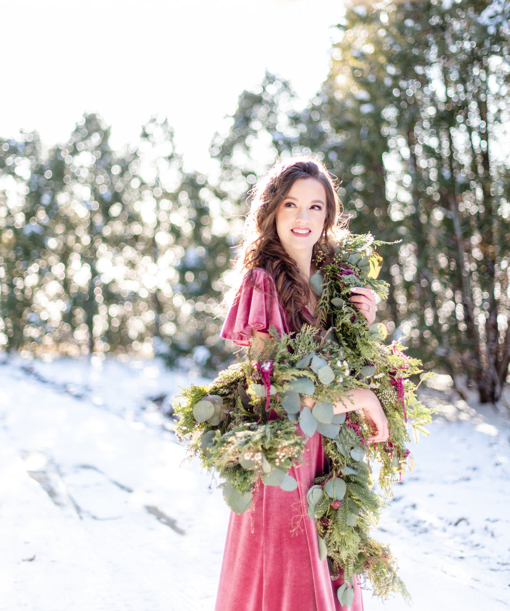 A walk in the snow, styled in a  soft velvet gown  and a gorgeous floral garland is a check off our 2019 goals list.