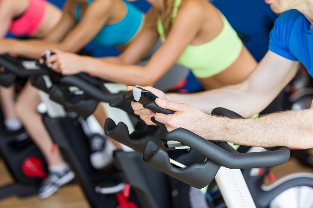 bigstock-Fit-people-in-a-spin-class-at--105537254.jpg