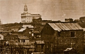 Joseph Bates Noble Carriage House and Outbuildings (Still Standing) with Nauvoo Temple in 1846