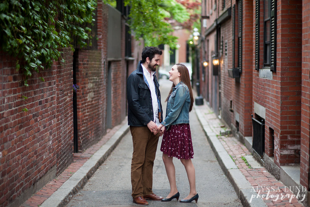 Relaxed engagement portrait in an alley